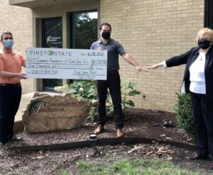 Large check donation to  Community Foundation of Eastern Ill
